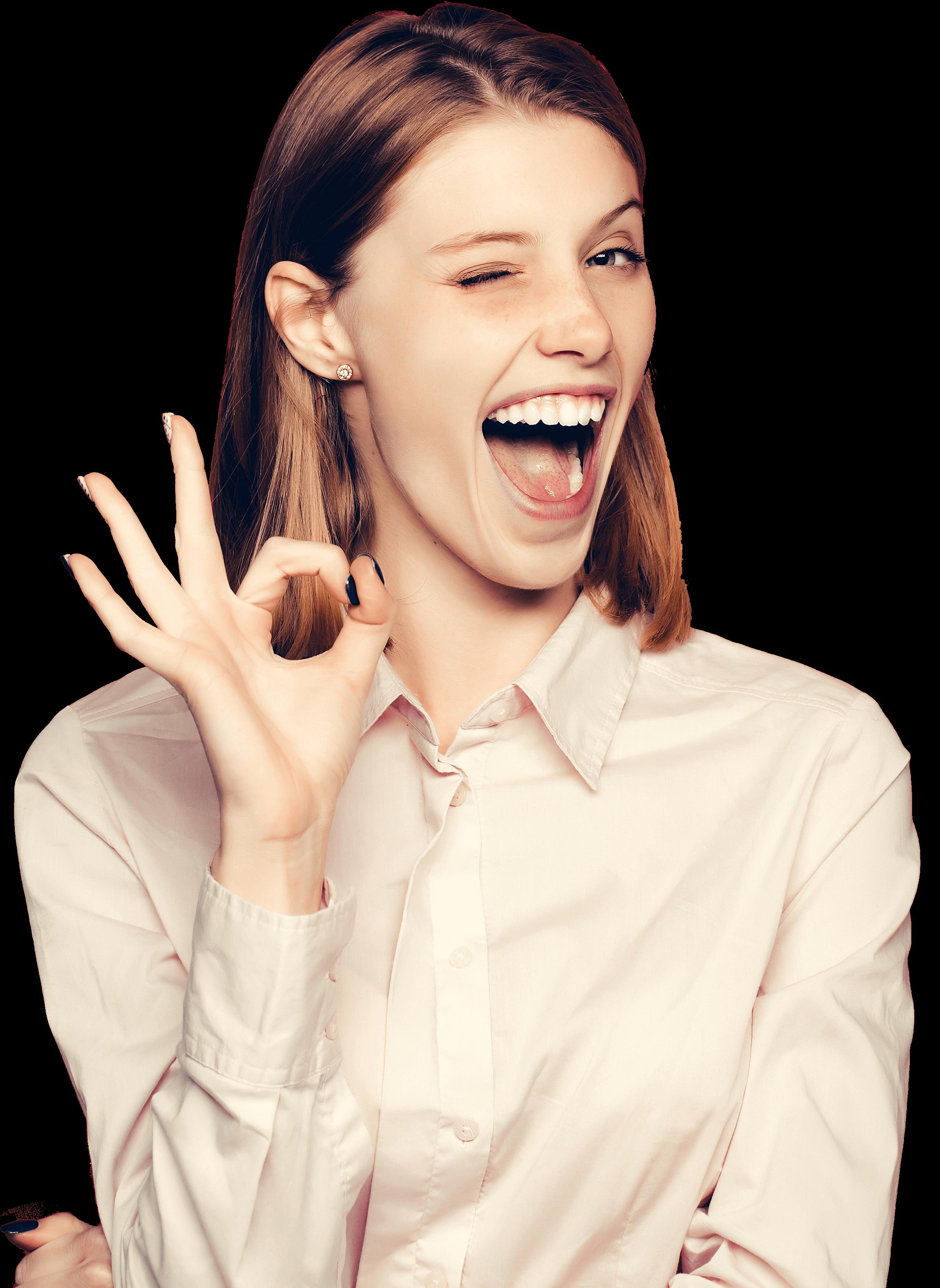 ההצגה הטובה ביותר בקמפוס - pretty girl young beautiful cute woman female model with red hair in white shirt shows ok gesture